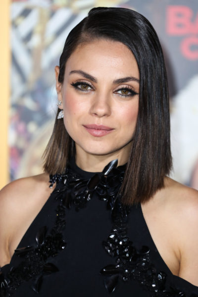 Mila Kunis wearing a Cushnie et Ochs dress and Christian Louboutin shoes arrives at the Los Angeles Premiere Of STX Entertainment's 'A Bad Moms Christmas'